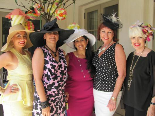 Neiman Marcus' Nicole Chapman, and tea co-chairs Julie Grad, Mary Amen, and Michele Hall join me for a photo at the Girls Inc. Hats and High Tea Party